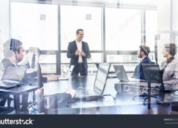 stock-photo-successful-team-leader-and-business-owner-leading-informal-in-house-business-meeting-businessman-561776362