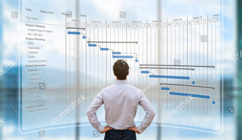 stock-photo-project-manager-looking-at-ar-screen-with-gantt-chart-schedule-or-planning-showing-tasks-and-713811001